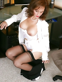 Amazing redhead mom with big tits in stockings