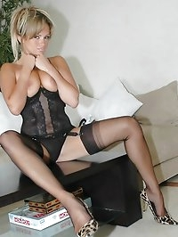 Chick has busty boobs in a corset