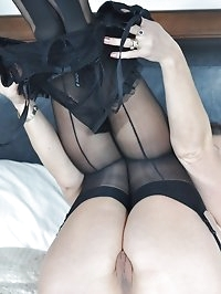 Sexy MILF Angela teases in black lingerie
