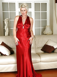 Elegant 43 year old Sally T in and out of a red evening gown