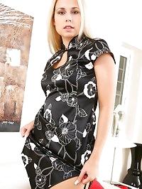 Beautiful blonde wearing black minidress, sexy red..