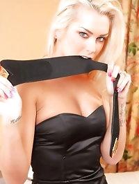 Saucy blonde siren Natasha Marley in sexy black evening..