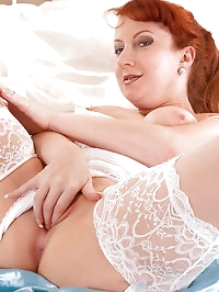 Anilos cougar Red wears her pantyhose while fucking her..