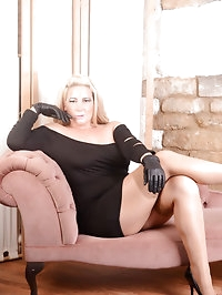 This kinky blonde likes putting on her new leather gloves..