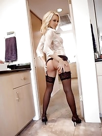 Jana Cova seduces you in just her black stockings.