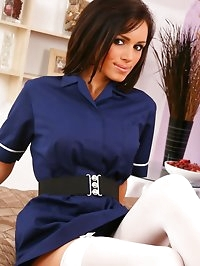 Naughty nurse Gemma shows off her sexy white stockings.