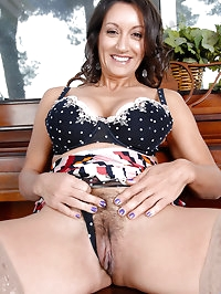 Persia Monir pops out her huge mature tits while spreading..