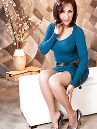 Nasty MILF in blue wearing sexy stockings
