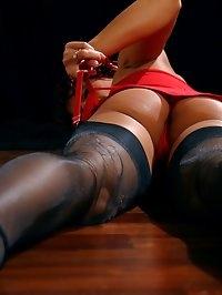 Redhead MILF slut in sheer stockings and high heels