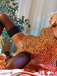 Leggy Milf Lily in stockings and oriental dress