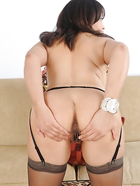 Busty Lala Bond shows off her garder and stockings in the..