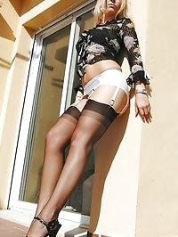 Blonde looks ravishing in garter stockings