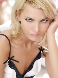 The lovely Jitka slips out of her white lingerie and..