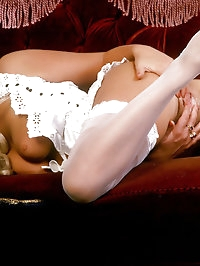 Babe in sexy white stockings shows off pussy