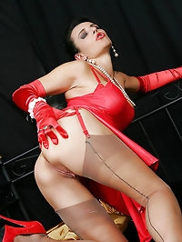 Splendid bitch in red dress and stockings