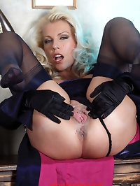 Lana wearing stockings and gloves as she finger fucks her..
