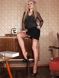 Alina dressed in sexy outfit shows her long legs in..