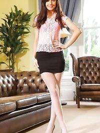 Sexy Caroline reveals pink suspenders in the study