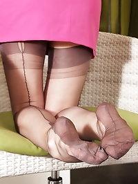 Alina smoke cigarettes in retro catsuit, stockings and..