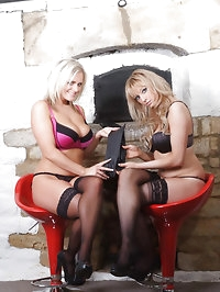 Two stunning blondes playing with each other with leather..