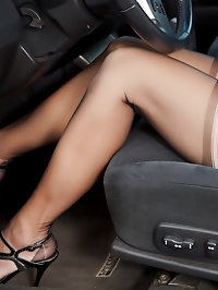 Stunning brunette mom wearing stockings in the car
