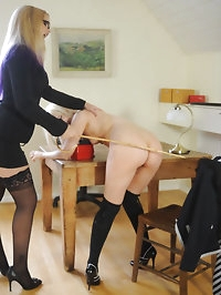 Blonde Miss Elise in stockings spanking schoolgirl Faye..
