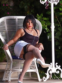 Girlie poses in a white thong