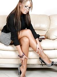 Sexy secretary Emma gets hot on the phone