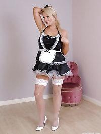 Sexy Maid Larissa in fishnet stockings and white stiletto..