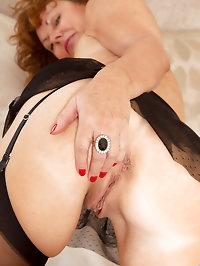 Anilos Cascade spreads her legs for a perfect view of her..