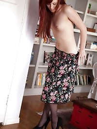 Elle starts in a flowery dress before quickly showing her..