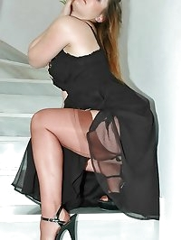 Naughty darling in sexy black dress