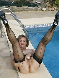 Mom gets near naked by the pool