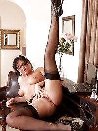 Sexy business woman Danielle strips down to only black..