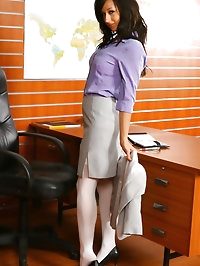 Beautiful brunette secretary Laura A strips from her cute..