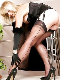 Astrid strips down to her corset and stockings