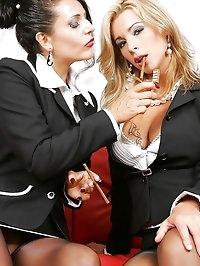 Two business ladies in stockings make out