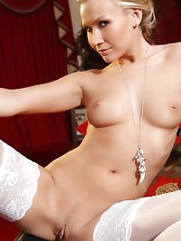 Michelle slips off her white panties to show off her..