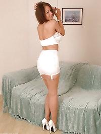 Leggy brunette in tan stockings and white high heels