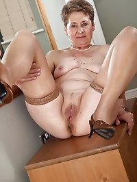 60 year old Dee shows off her shaven mature pussy in this..