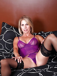 Jenny Mason teasingly flaunts her mature body in violet..