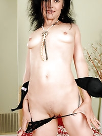 Petite mature brunette Claudia K slips off her slinky..