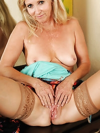 55 year old Annabelle posing in her red hot thongs and..