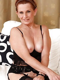 Mature housewife Lucy O peels her 58 year old pussy lips..