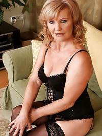 Gorgeous 57 year old Lena F slips out of her slinky..