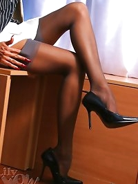 Leggy secretary LilyWOW in thin vintage stockings and high..