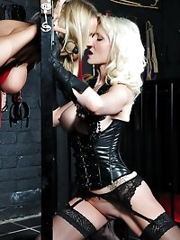 Sexy blonde lesbian gags hot Milf in the stocks and gives..
