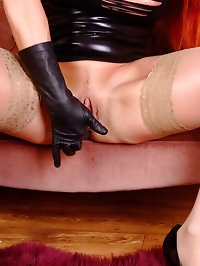 Busty Redhead Faye shows you her buttery leather gloves..