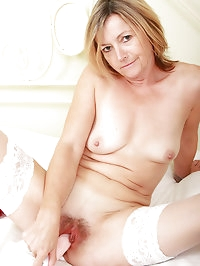Sexy 48 year old Susie slams a large plastic dildo into..