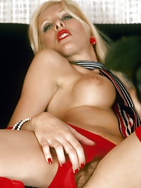 Blond lady showing of the first ever implants